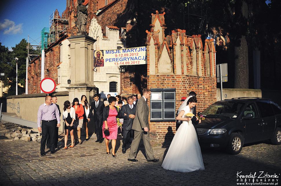 Ślub Kamili i Łukasza - fotografia ślubna Toruń, wesele Hotel 1231, Kościół św.Jakuba - 38.