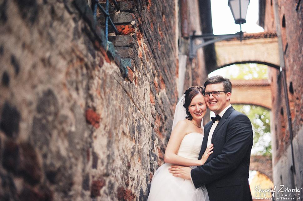 Ślub Kamili i Łukasza - fotografia ślubna Toruń, wesele Hotel 1231, Kościół św.Jakuba - 151.